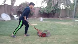 Grass cutting in our cricket ground