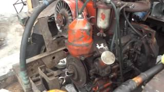 Жөндеу жетегі НШ-10 қолдан жасалған трактор.