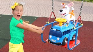 Sofia plays with toy Minibus on Outdoor Playground for Kids