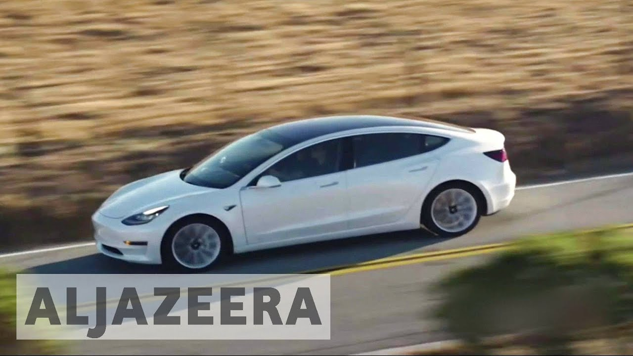 Tesla launches its first affordable electric car - Model 3 - YouTube