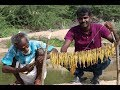 Traditional style fire fish prepared by my daddy / Village food factory