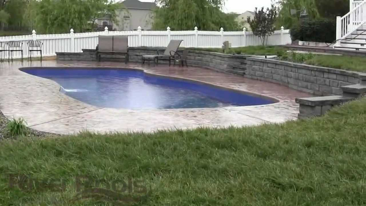 Gorgeous fiberglass pool w retaining wall solutions for for Pool design sloped yard