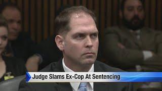 Judge slams ex-cop at sentencing