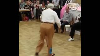 Cute elderly couple dancing like young kids