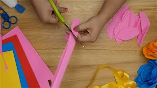 Art and Craft - An Indian girl cutting strips of pink craft paper