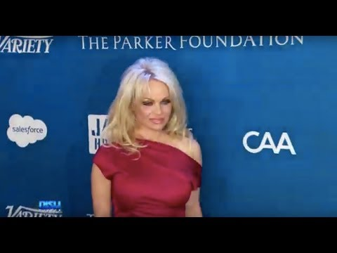 PAMELA ANDERSON SPLITS FROM JON PETERS AFTER 12 DAYS OF MARRIAGE