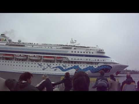 Cruise ship AIDA arrives in Amsterdam (camera shakes because of waving to passengers)