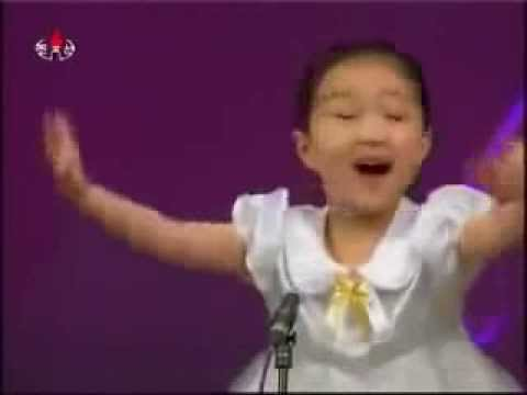 Small cute North Korean girl singing - very lovely voice & expressions Travel Video