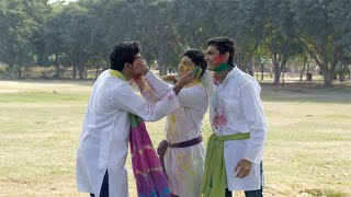 Young friends in traditional clothing celebrating Holi festival together in a park