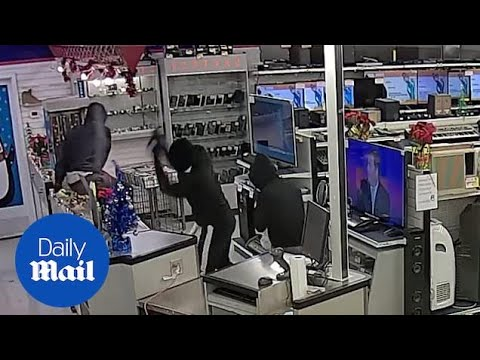 Heavily-armed gang carry out smash-and-grab pawn shop raid