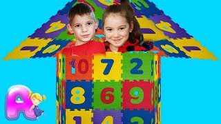 Anna and Victor with Numbers Bloc House Make  by Anna