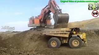 Hitachi EX5500 Excavator Loading CAT 789 Dump Truck Open Pit Mining
