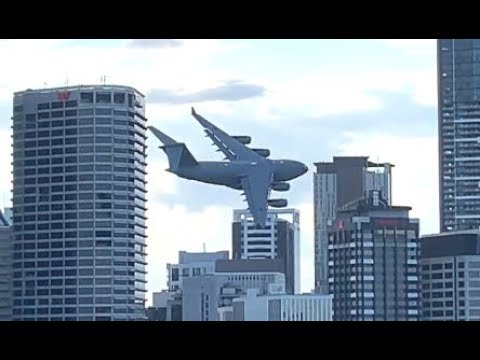Flying A Giant Plane Between Buildings