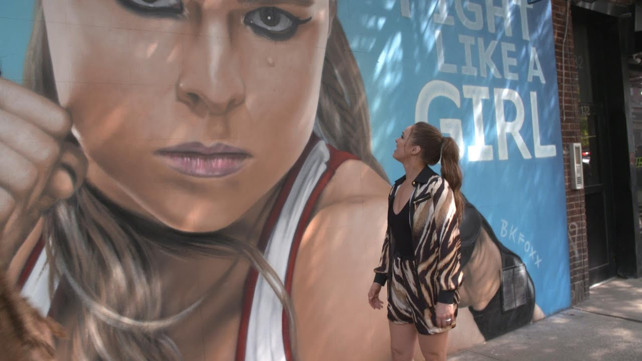 Ronda Rousey sees her custom mural emblazoned on the front of a New York City building
