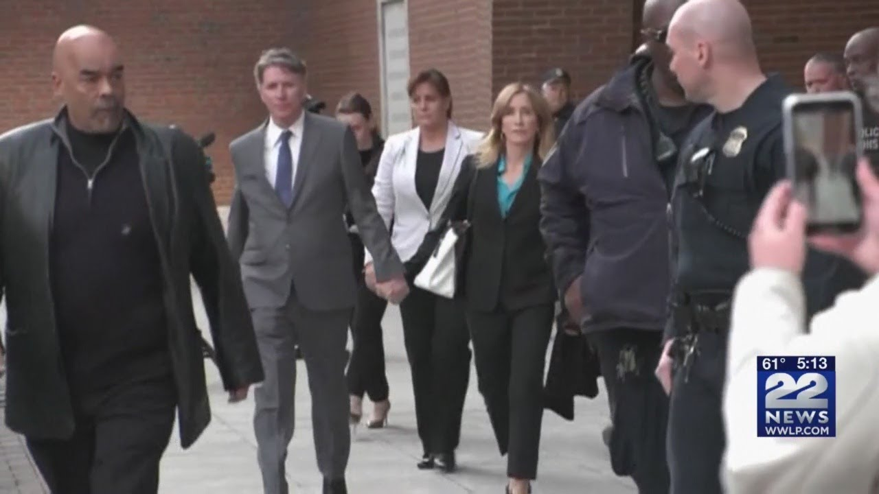 Felicity Huffman reports to prison to start two-week sentence for college admissions scam