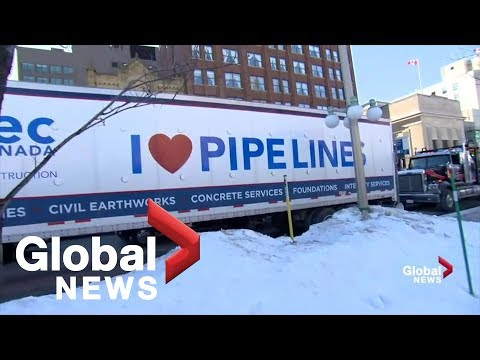 Large convoy of trucks arrives in Ottawa to protest federal government