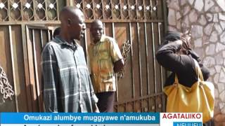 Omukazi alumbye muggyawe n'amukuba thumbnail