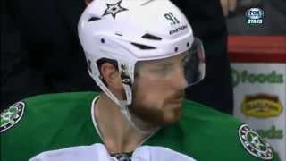 Equipment manager feeds Tyler Seguin chocolate on the bench after goal