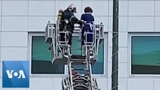 Ladder Used to Rescue Woman in Greek Hotel Fire