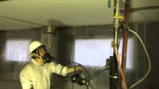 Pearson Enterprises 12 inch hydro blasting system removing asbestos coating covered in paint