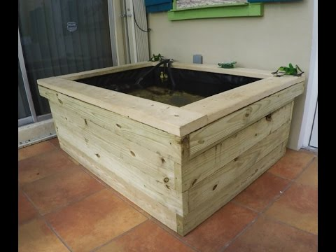 Above ground small Koi Pond made with 2x6 wood, Fish mate 3000P-UV and tetra 550 GPH