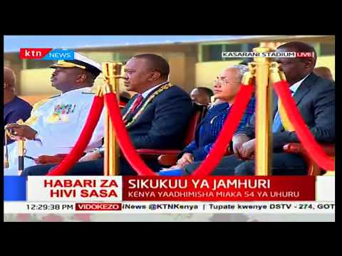 Military personnel parade in front of President Uhuru Kenyatta during Jamhuri day celebrations