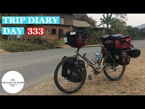 Daily Vlog - Trip Diary - Day 333 - Caught In The Storm. Cycling Laos