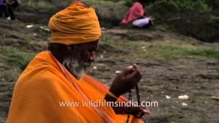 A sadhu meditate counting Rudraksha mala: Nashik Kumbh mela