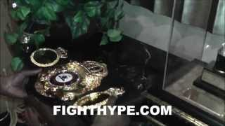 FLOYD MAYWEATHER DISPLAYS NEW SOLID GOLD WBC TITLE NEXT TO FIRST BOXING TROPHY EVER WON AT AGE 10