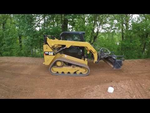Cat 259D with Harley Rake