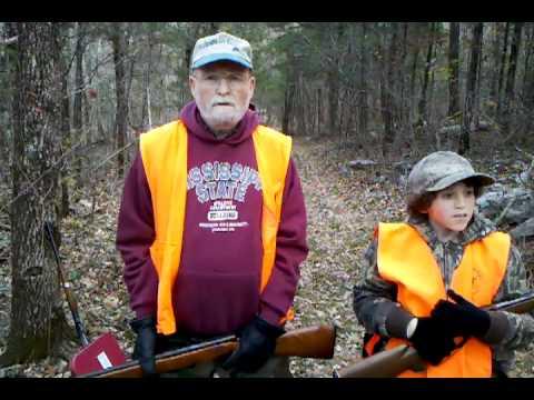 John Dudley teaching his son Luke how to hunt for deer
