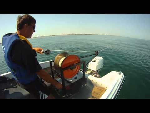 Paragliding winch tow on the boat