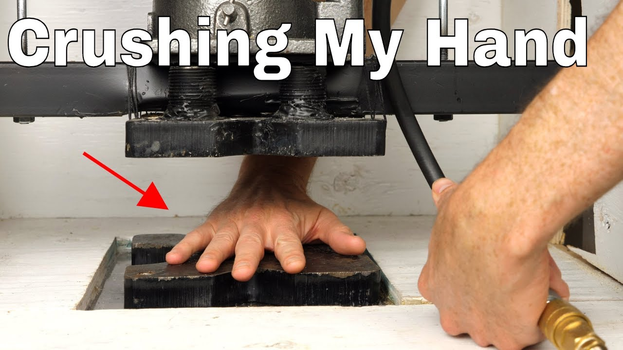 crushing my own hand in a hydraulic press crazy experiment on my