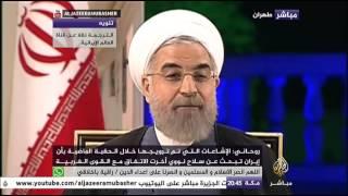 لقاء مع الرئيس الإيراني روحاني حول الإتفاق النووي الإيراني