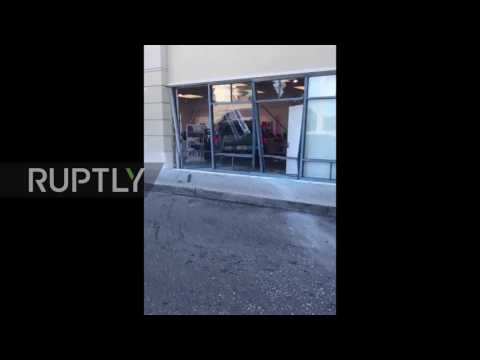 USA: Angry customer rams SUV into T-mobile store