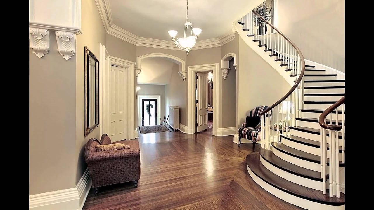 Home entrance foyer with staircase foyer interior design for Wallpaper for home entrance