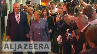 German elections: Angela Merkel wins fourth term as far-right AfD surges