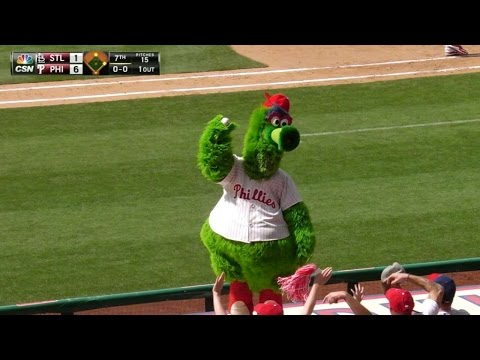 Phillie Phanatic dives on dugout to get ball