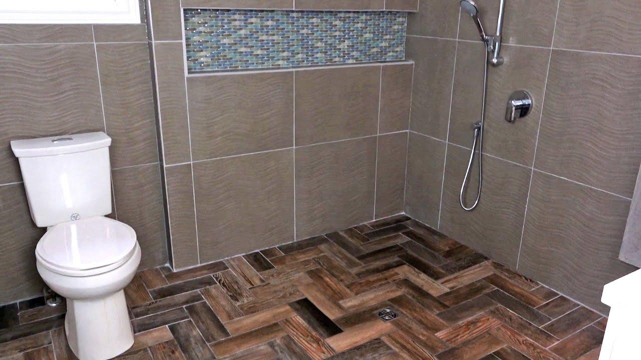 a herringbone tile shower floor
