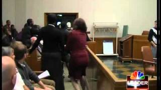 Fight breaks out at killer's sentencing