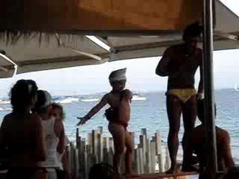 Dancing kid at Malibu beach club Ibiza