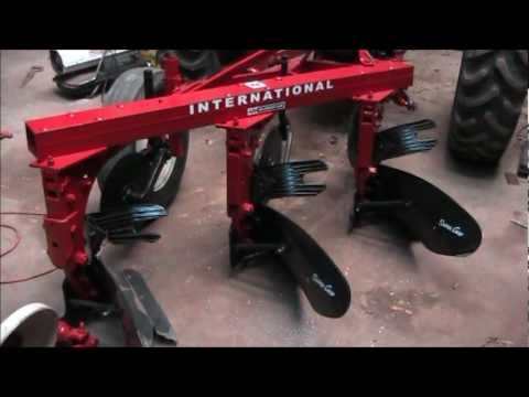 three bottom plow parts