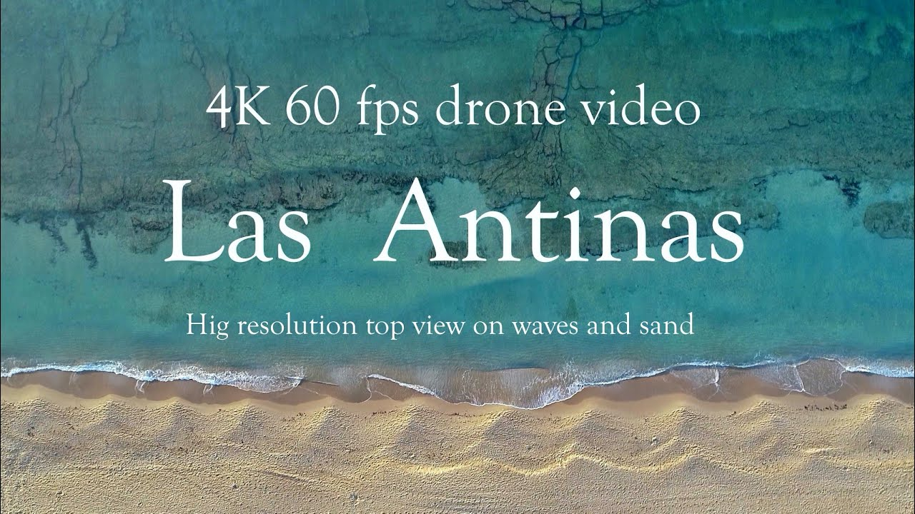 4k Utra HD drone video: Top view of sea waves and sea bottom rocks Las Antinas