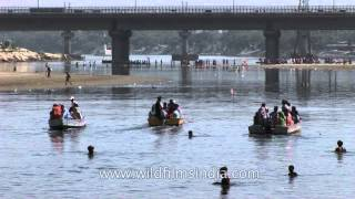 Ganpati lovers sailing through Yamuna river after the immersion rituals