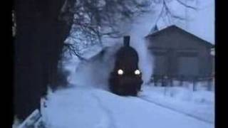 Steam train in the snow. thumbnail