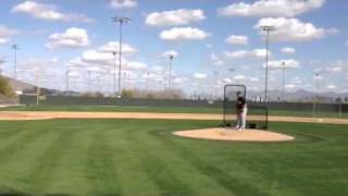 Joey Devine throws batting practice