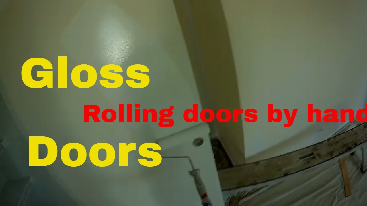 Glossing doors by brush and roller while hanging in a repaint. & Glossing doors by brush and roller while hanging in a repaint. - YouTube