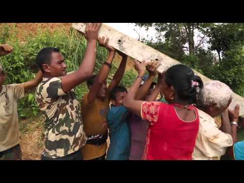 How to install an electricity pole - village style