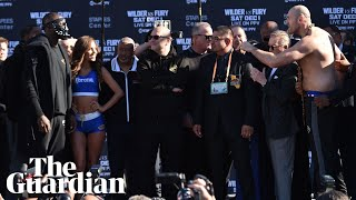 Tyson Fury and Deontay Wilder weigh in before heavyweight title fight