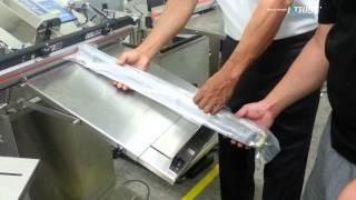 금속기계부품을  AZA-450-ES 경사조절 진공포장기…